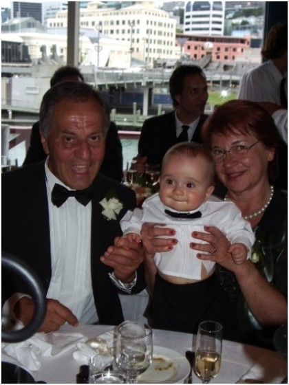 My beloved Mum and Dad holding their first born grandchild Orlando on our wedding day. A very precious image